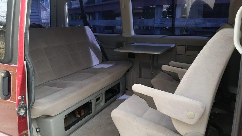 Grey interior of a burgundy Volkswagen Eurovan.