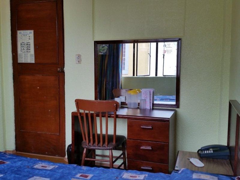 hotel room desk and mirror.
