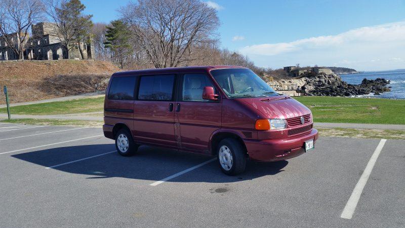 A burgundy Volkswagen van.