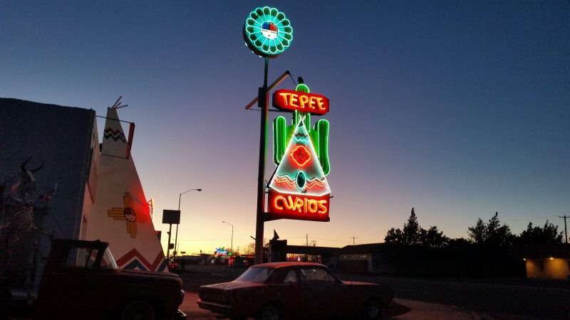 Neon sign for a curio shop on the Route 66 Mother Road in Tucumcari New Mexico.