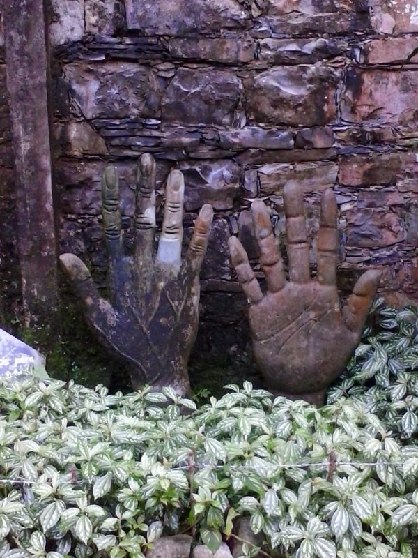 Oddly-shaped concrete installations featuring two right hands, in the jungle at Parque Edward James in Xilitla, Mexico.