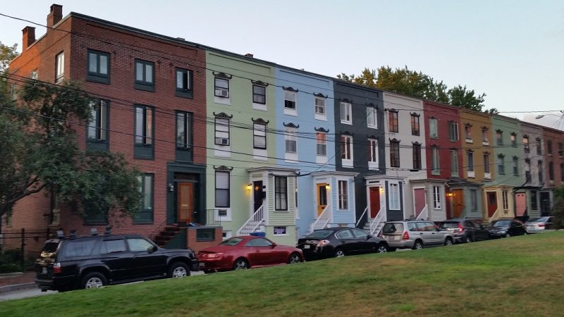 A row of colorfully painted apartment buildings in Portland, Maine.