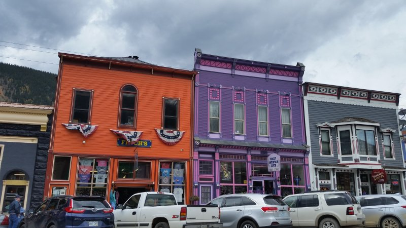 colorful old purple and orange wood shops in silverton, colorado.