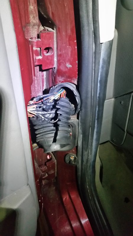 exposed wiring in a broken rubber casing.