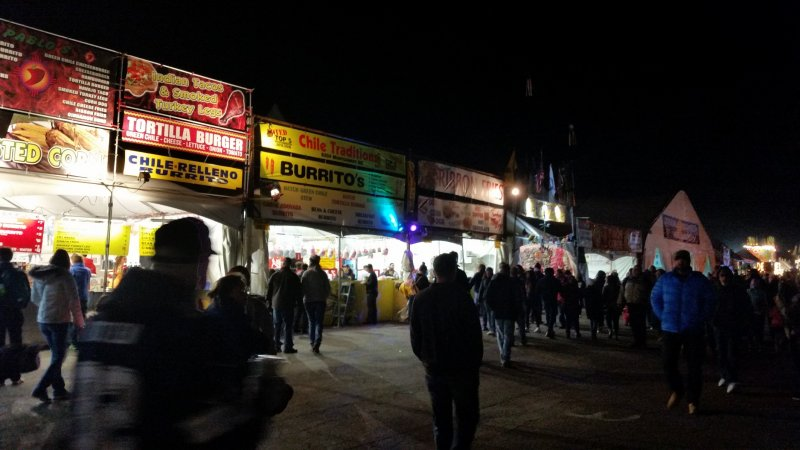 concession stands on the midway at night.