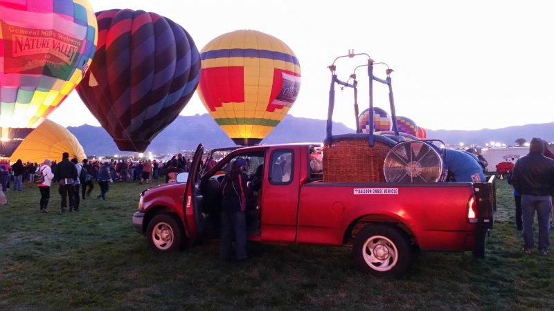 Balloon Crew truck with a gondola in the back at the Albuquerque International Balloon Fiesta.
