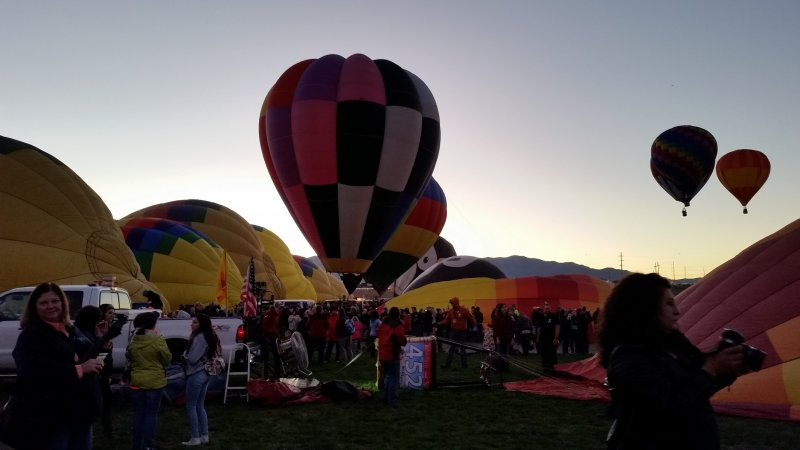 Hot air balloons slowly inflating prior to lift off.