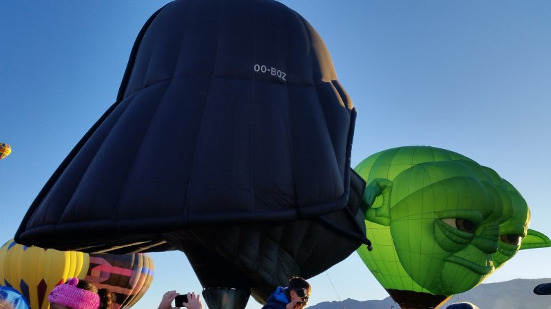 Close up of Yoda and Darth Vader special shape hot air balloons at the Albuquerque. International Balloon Fiesta