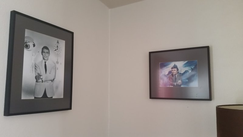 Two framed prints of Rod Serling from the The Twilight Zone.