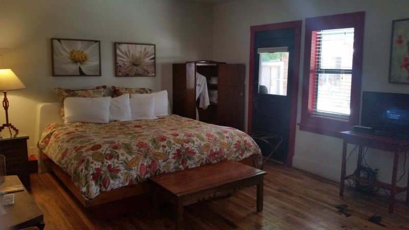 Babaloo Suite, Blackstone Hotsprings, New Mexico, complete with a floral pattern bedspread.