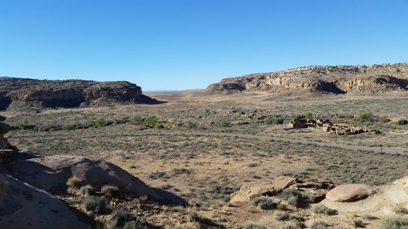 A view of the South Gap of Chaco Canyon against a clear blue sky.