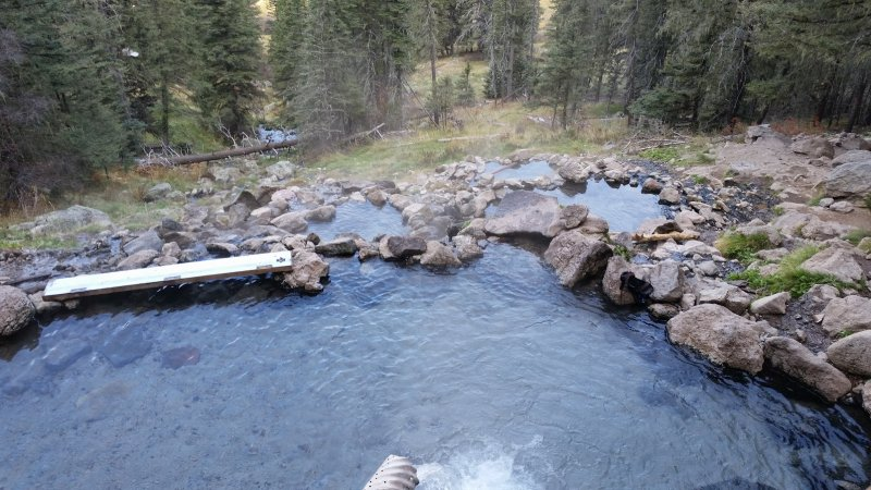 Several steamy, clear pools from one of the wilderness hot springs New Mexico is famous for.