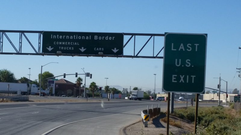 A green sign with white lettering stating last U.S. exit before crossing into Mexico.