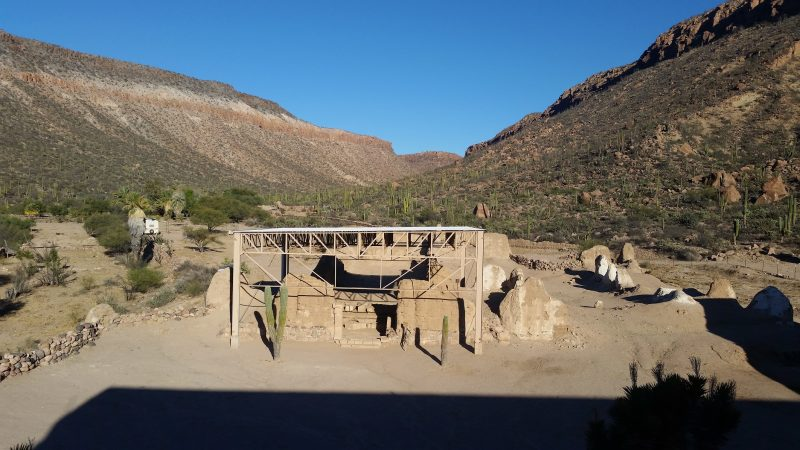 adobe ruins with steel awning