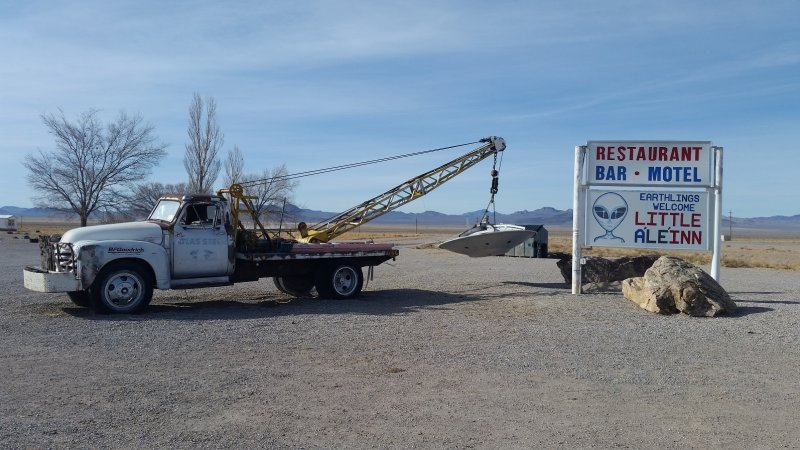 A tow truck in Rachel, Nevada towing a UFO.