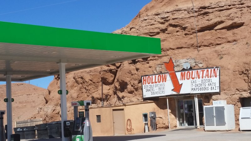 A shop built into a hollowed out red rock in Utah.