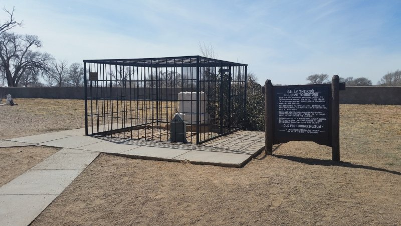 a cage that protects the grave of billy the kid in New Mexico.