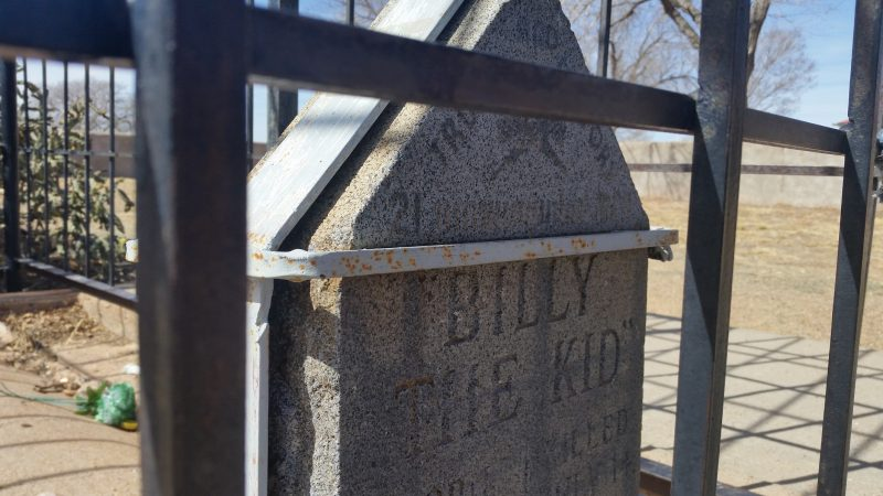 The tombstone of Billy the Kid encased in steel cages near Fort Sumner, New Mexico.