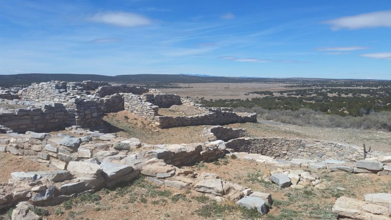 Stone ruins on the plains south of Albuquerque with mountains in the distance.
