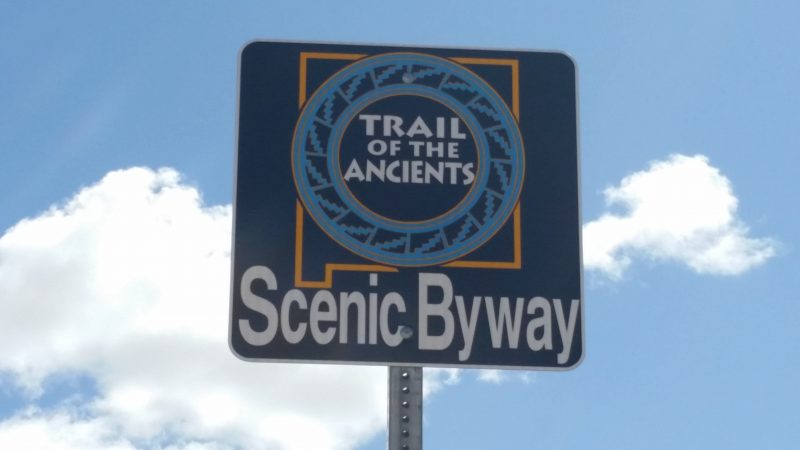 A road sign for the Trail of the Ancients Scenic Byway in New Mexico.