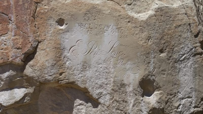 Ornate carved signatures on Inscription Rock at El Morro National Monument.