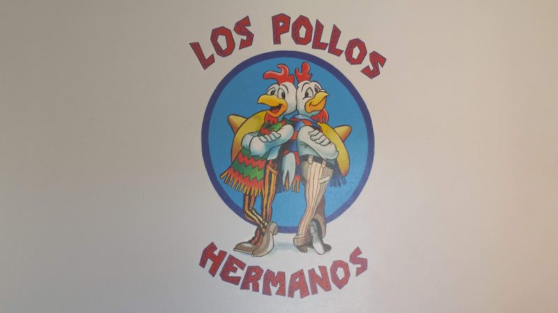 The Los Pollos Hermanos logo from the Breaking Bad television series on a wall at the original filming location.