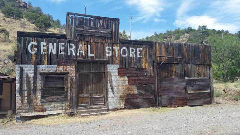Abandoned wooden General Sotre building with some rusted tin siding at Mogollon ghost town in New Mexico.