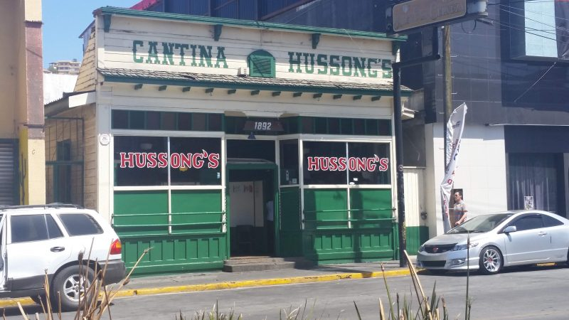 Exterior of the old green and white painted building of Hussong's Cantina in Ensenada, Baja California, Mexico.