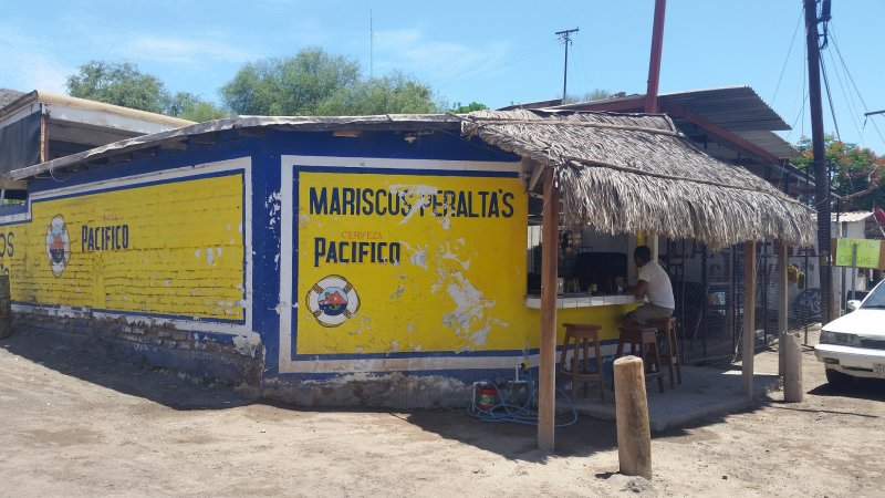 Front of Mariscos Peralta's blue and yellow taco stand, a place popular for Baja California fish tacos in Mulege, Mexico..