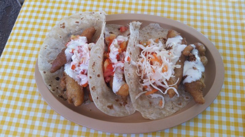 A plate of fish tacos on a gingham tablecloth at Taquitos Del Valle, Loreto, Baja Sur, Mexico.