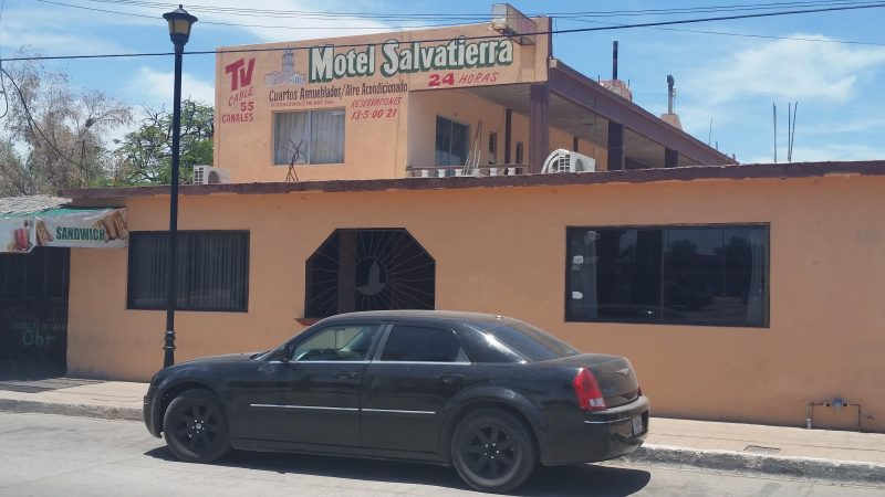 The orange Motel Salvatierra, a popular budget accommodation option for travelers on a road trip in Baja California.