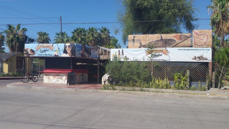 Street view of a seafood restaurant in Loreto, Mexico.