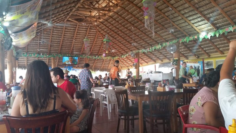 Under the palapa roof of a seafood restaurant in La Paz, Mexico.