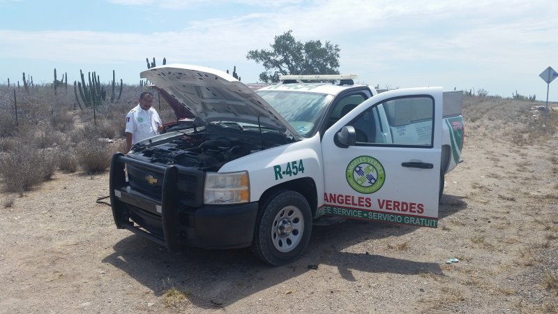 A Green Angels truck with the hood up on the side of the road in Baja Mexico
