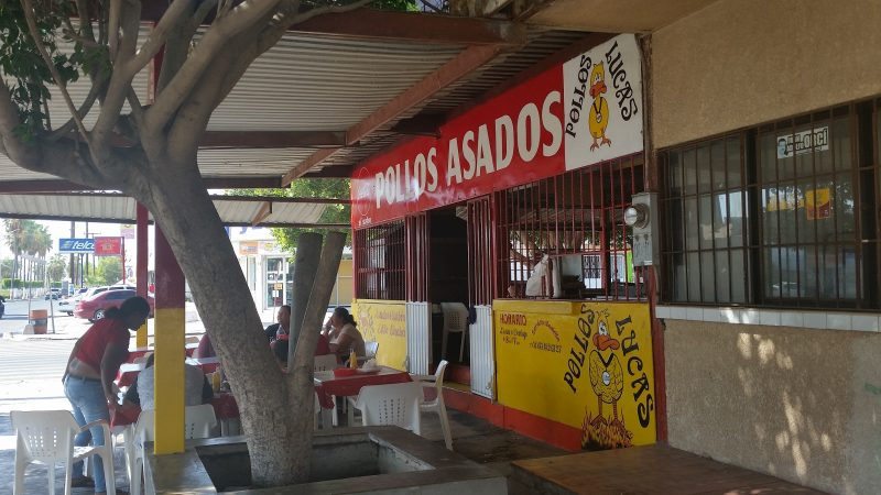 The outside of a roast chicken restaurant in Mexico.