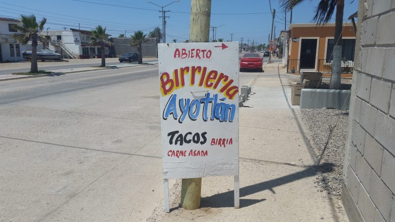 Colorful birria sign on the sidewalk in Guerrero Negro, Baja California Sur, Mexico.