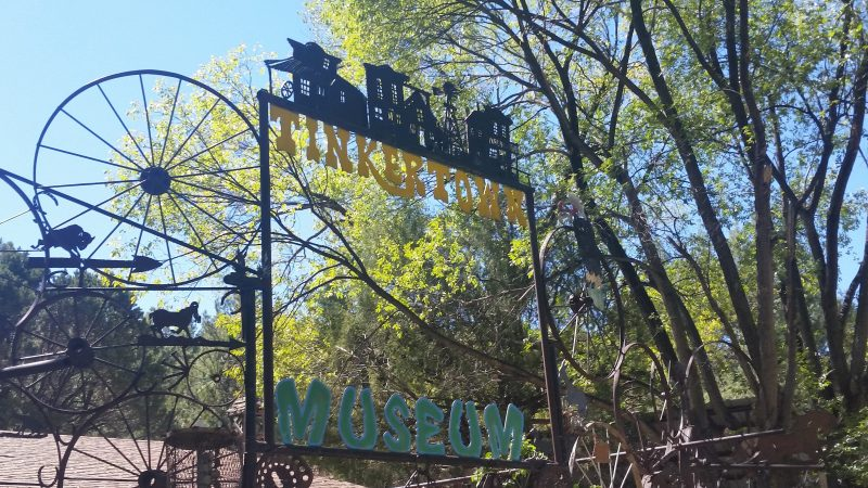 A stylistic sign for Tinkertown Museum, one of the more quirky day trips from Albuquerque.
