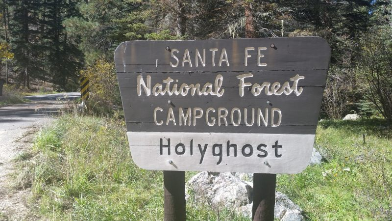 A an official sign for Holy Ghost Campground, part of Santa Fe National Forest in New Mexico.