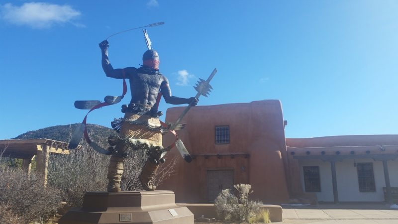The large Apache Mountain Spirit Dancer statue in the courtyard of Museum Hill in Santa Fe.