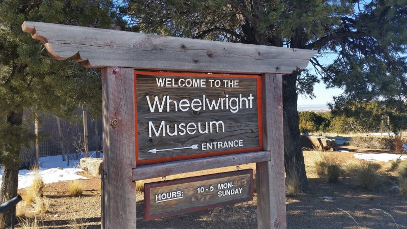 A carved wooden sign for the Wheelwright Museum in Santa Fe, New Mexico.