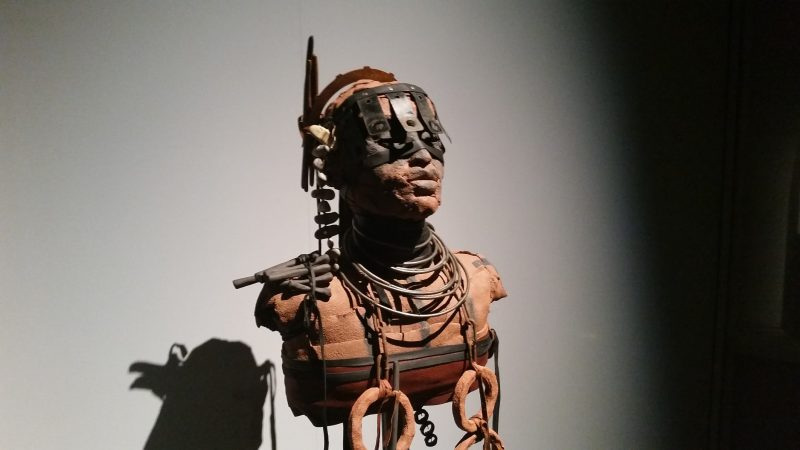 A stylized, industrial-looking terracotta figure from artist Rose B. Simpson on display at Museum hill in Santa Fe.