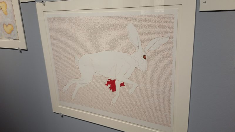 A piece pf artwork at Museum Hill in Santa Fe from artist Bob Haozous featuring a bleeding rabbit.