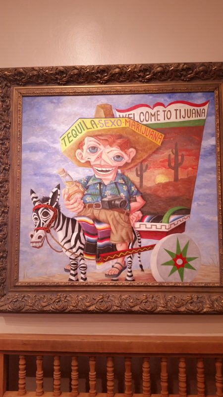 Caricature painting of a drunk U.S. tourist at a museum in Santa Fe, New Mexico.