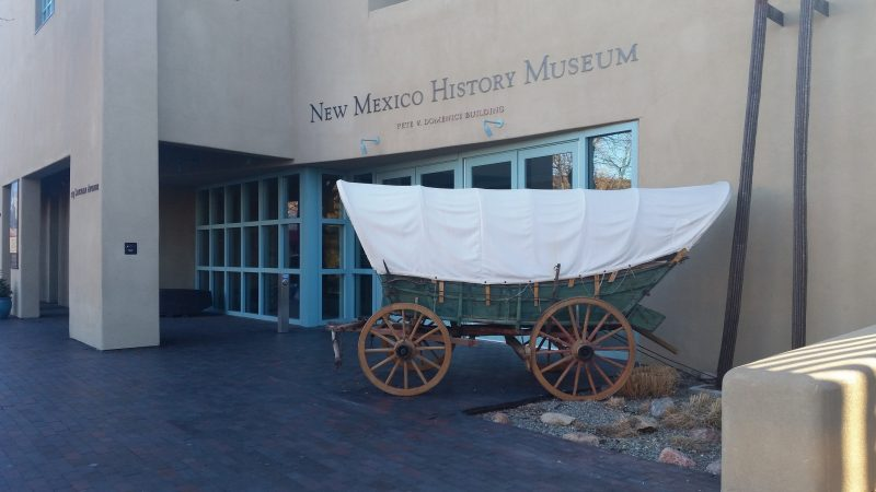 A covered wagon outside the New Mexico History Museum.