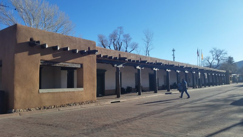 The brown, timber-beamed portals at the Palace of the Governors on Santa Fe's Historic Plaza.