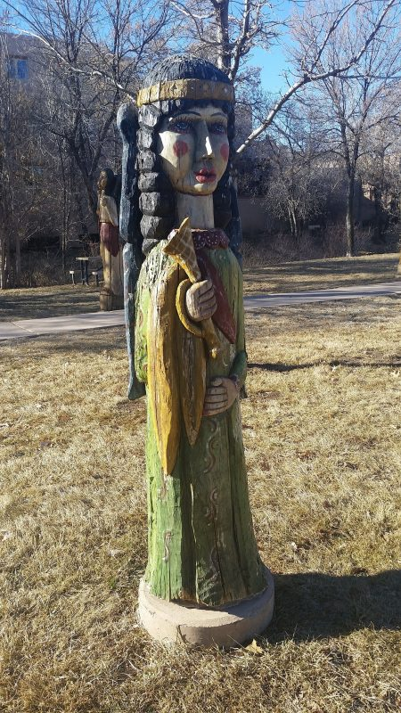 Sculpted and painted tree trunks of angelic figures.