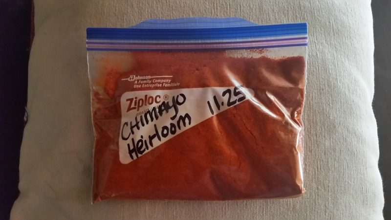 A Ziploc bag of ground red Chimayo chile powder from New Mexico.