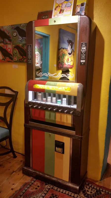 A converted old art-o-mat cigarette vending machine now used to dispense small and unique works of art.