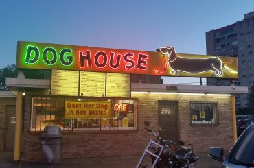 Green and red neon dachshund dog house sign in Albuquerque New Mexico.