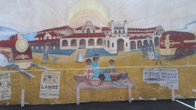 One of the Albuquerque murals depicting Santa Fe Railroad and historic Alvarado Hotel Albuquerque with Native Americans and native pottery in the foreground.